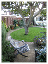 View from small patio in autumn.  Design for a small garden in Bedfordshire.