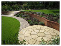 Circular sitting area (patio) and view across the garden – after design, construction and planting.