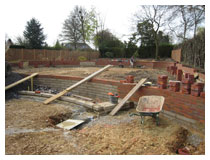 Landscaping – building retaining walls.  Levels were made up using good quality screened topsoil with added compost.  Garden landscaping design in Harpenden.