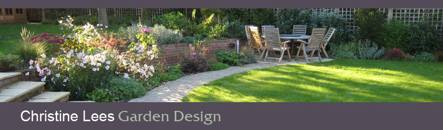 Patio surrounded by lawns and attractive planting. Design for a garden in Hertfordshire